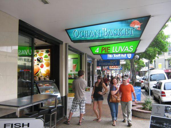 Gold Coast shop signage - people walking past